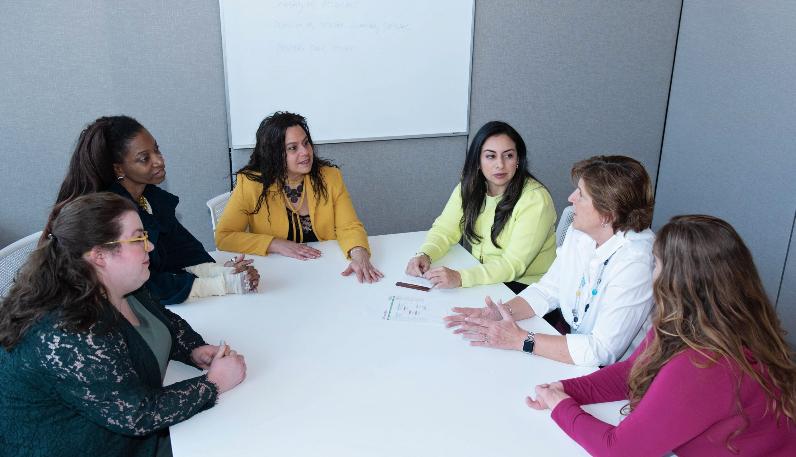 Wise Women Business Professional Center Photo Round table talk together six